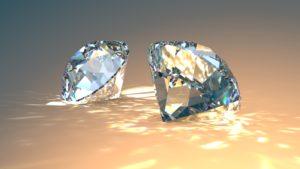 ダイヤモンドTwo diamonds jewel isolated on yellow gradient background with sparkling.